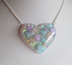 Iridescent Glittery Mermaid Shells Heart Shaped by CandyShockUK Kawaii Accessories, Kawaii Jewelry, Clear Casting Resin, Pastel Candy, Mermaid Shell, Opal Color, Resin Art, Iridescent, Heart Shapes