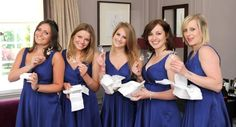 Stunning bridesmaids in beautiful blue dresses opening their Hermione Harbutt May Blossom hairpins.