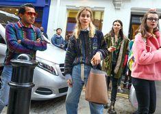 Miguel Enamorado in Gucci and Irina Lakicevic in a Balenciaga top with a Céline bag