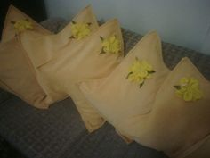 Yellow velvet covers with pretty hand-made flowers.