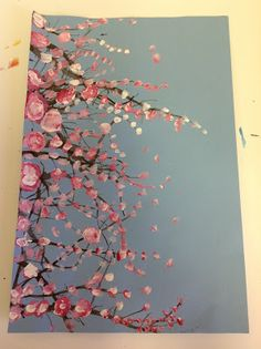 Cherry Blossom trees done by using a finger as the brush and purposefully mixing the three colors of pink while wet.