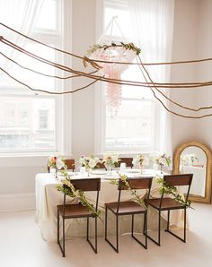Budget Wedding and Party Decor Ideas    Isn't this a pretty table setting?  You could re-create this tablescape on multiple tables for a wedding or large celebration. Or use it for a more intimate luncheon or dinner