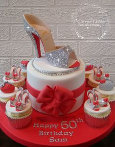 https://flic.kr/p/Dj6fmF | Swarovski Encrusted Louboutin Cake | Over 1000 hand placed crystals on the big shoe.  I will not be repeating that in a hurry!  Vanilla sponge with matching (edible) cupcakes.