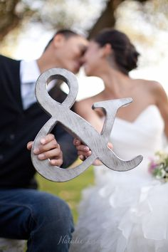 "Something so cute and simple about this ampersand ""&"" wedding photo"