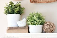 Spring Mantel Decorating Ideas - books and neutrals to compliment the w-g