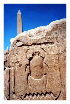 JOJO POST STAR GATES: Karnak Scarab - Luxor I took this@ Karnak Temple in Luxor,Egypt in 1998, I was trying to get a nice close-up of what I thought was a particularly well-preserved hieroglyph; the obelisk in the background was just icing on the cake.  Karnak Temple is absolutely incredible - a must-see. In my humble opinion, it was even more impressive than the great pyramids, seeing as there is still paint on some of the walls and ceilings!