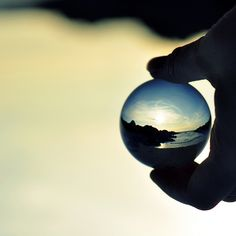 landscape reflected in a glass sphere.