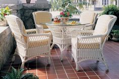 Concord Wicker Dining Set Featuring a vintage open-patterned weave, the Concord dining set will make you want to linger over any meal. White Wicker Patio Furniture, Wicker Dining Set, Sunroom Furniture, Dining Arm Chair, Outdoor Furniture Sets, Wing Chairs, Oriental Furniture, Sofa Chair, Chair Cushions
