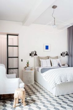 #MyDomaine tip: When decorating your bedroom layer your lighting, like this bedroom does.