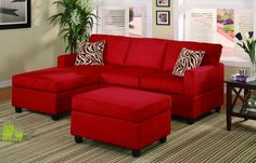 COLOR : red couch. Red adds energy to this room. It makes it more uplifting. I really like this room. wouldn't change it.