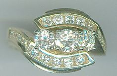 This custom, hand wax carved ring was made using all the client's diamonds except one. She used her own gold as well.