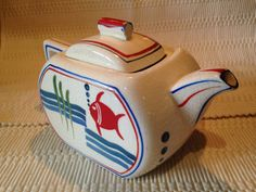 A personal favorite from my Etsy shop https://www.etsy.com/listing/244472069/rare-vintage-fishbowl-teapot