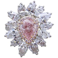G.I.A. Intense Pink Diamond Ring set in rose gold surrounded with 24 natural pink brilliant diamonds