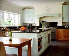 Ooooh, this light mint green is a winner :) Maybe in the future house? {Oh kitchen, I love you.}