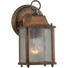 Brighten up the look of your garden, patio, or deck with this 1 Light Outdoor Wall Lantern. This wall lantern is made from die-cast aluminum, which ensures years of functionality and reliable use. It accommodates an incandescent bulb of 60W that illuminates your outdoor space. The wall lantern exhibits a contemporary flair, with an intricate design on a glass shade. It is available in numerous finishes, so choose the one that best complements your outdoor space. This 1 Light Outdoor Wall…