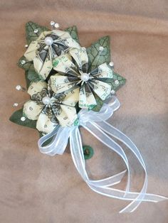 Beautiful money corsage made with money flowers.  Perfect for graduations, proms, weddings, and more!