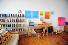 Oakland Painter's Loft: Sometimes less is more. Minimalist prints and a clutter free work area really get the job done. Plus, those are vintage LUNCH BOXES on the shelves — how awesome are they?!