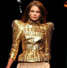 United Arab Emirates based designer Khalid bin Sultan Al Qasimi's broad shoulders in his runway couture at London's Fashion Week.