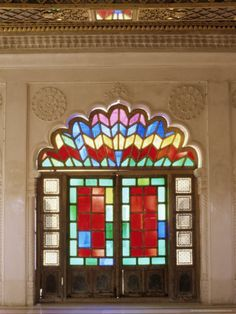 Original Old Stained Glass in Doors and Decorative Jali Wood Carving in Door, Jodhpur, India.