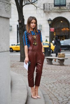 Miroslava Duma rocking a pair of deep oxblood leather overalls by Acne, upping the luxe factor in a what has historically been a denim-only look #StreetStyle
