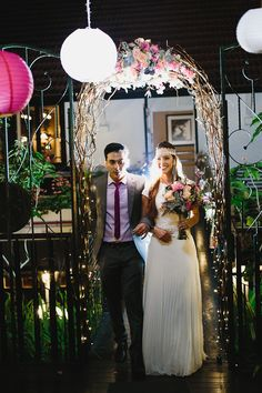 Floral arch and fairy lights! Isaac and Katrina's Bohemian Chic Singapore Wedding at Nosh, Rochester Park. http://www.theweddingscoop.com/entry/isaac-and-katrina-s-bohemian-chic-wedding-at-nosh