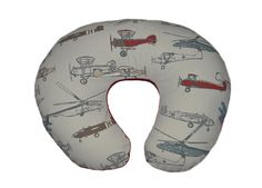 """Vintage airplanes boppy pillow cover with soft red minky backing. There is a 22"""" invisible zipper on the outside so that the cover can be easily taken off for washing. Handmade in Phoenix AZ, ships to"""