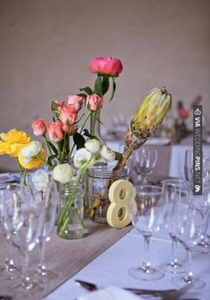 pretty pastel proteas and wooden numbers for simple but fresh decor | CHECK OUT MORE IDEAS AT WEDDINGPINS.NET | #weddings #weddingdecor #weddingdecoration #decor #decoration #events #forweddings