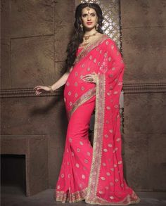 1. Coral pink georgette sari  2. Highlighted with zari and resham embroidery embellished with rhinestones  3. Heavy embroidered border running all over 4. Comes with a matching semi stitched bluse with embroidery