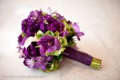 This purple and green wedding bouquet features Holland hydrangea, orchids, calla lilies and stock. Florals by freshdesign. Photography - m three studio