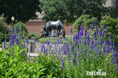 """Picturesque Dillingham Garden provides a beautiful frame for H Holden's """"Holding the Claim,"""" in Enid, Okla."""