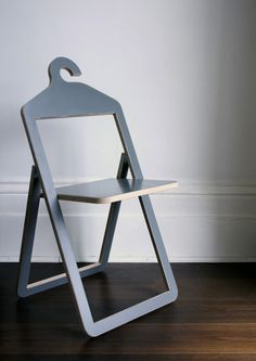 """Designed by Philippe Malouin. """"This is an interesting concept where a chair can also be a coat hanger. Designed to fold flat, you can actually hang jackets on it in the closet or just store on the hanger bar for future use. Though an interesting idea, I have yet to figure out what you do with all of your jackets when you need to use the chairs, but I might be over thinking it."""""""