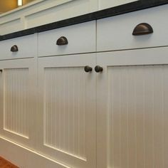 Farmhouse - Kitchen Hardware Ideas - Bob Vila; Beadboard and oil rubbed bronze hardware.