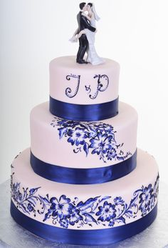 Beautiful Blue Floral Wedding Cake with our Kissing Couple Cake Topper....Designed by Pastry Palace LV W802 – Painted Blooms (http://pastrypalacelv.com/w802-painted-blooms/)