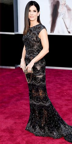 Sandra Bullock in an Elie Saab gown with Harry Winston jewelry, Jimmy Choo shoes and a Daniel Swarovski clutch at The Academy Awards 2013