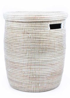 Handwoven baskets made from natural grasses and plastic. Fair trade from Senegal.