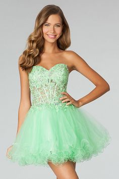 "Start out searching for your perfect short strapless green prom dress by flipping through magazines and online to see what kind of dress you are most attracted to. Then hit the stores with an idea in mind of what you are looking for. Try on as many dresses as you can; your idea of the ""perfect dress"" may not be as well suited for you as another style. Don't limit yourself."