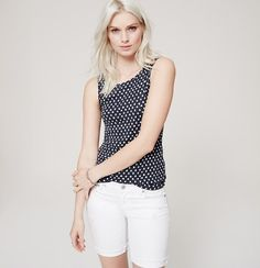 Delicately dotted, a sleek tank in an oh-so-soft cotton knit is an everyday must-have. Scoop neck. Sleeveless. Banded trim with tonal topstitching at neckline and armholes.