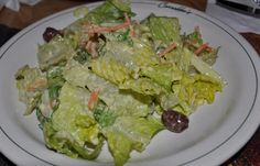 Carrabas Salad Dressing    ¼ cup milk   ½ cup mayonnaise   ¼ cup grated parmesan cheese   1 tspn white wine vinegar   ¼ tspn Worcestershire sauce       Gradually blend milk into mayonnaise.     Mix in cheese, vinegar and Worcestershire sauce. Chill.     Serve on tossed salad greens.     Makes ¾ cup