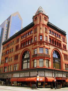 a filleted tower is placed to emphasize the corner . .  . the old Levy Department Store building . . .  today it houses Louisville's Spaghetti Factory restaurant