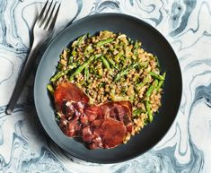 The asparagus offers a fresh snap that keeps the dish feeling springy and light, and a single slice of crisped prosciutto on top of each serving prove Fresh Asparagus, Fresh Chives, Prosciutto Recipes, Dry White Wine, Weeknight Dinners, Saturated Fat, The Dish, Risotto, Crisp