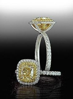 Fancy Yellow diamond with yellow and white pave frame.