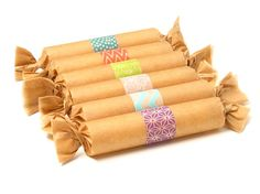 paper towel or toilet paper roll with t-shirt inside wrapped with washi tape embellishment