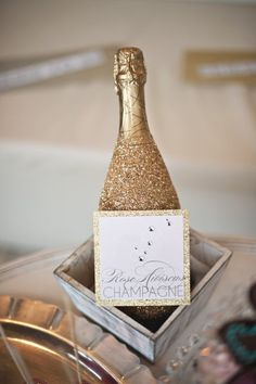 Cover the bottle with glitter then give to maid of honor!