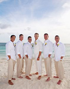 Beach Wedding Groom & Groomsmen's Style.  Diffrent color flowers and slippers LOVE THIS
