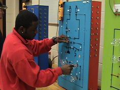 Student troubleshooting in the Electrical Controls lab