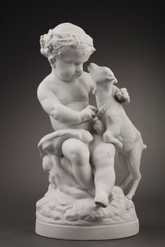 A soft-paste biscuit porcelain statue representing Bacchus child, his front surrounded by a crown vine, playing with a kid. Sitting on a rock, he holds in his left hand...