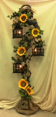 Gorgeous 3 Tier Lantern with Burlap, Sunflowers and Crows made by our very own Tammy!