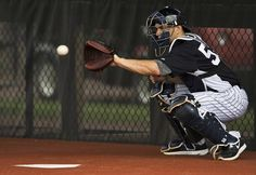 New York Yankees catcher Russell Martin targets a pitch during a bullpen session