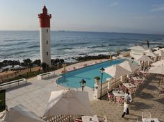 Perched on the coast of KwaZulu-Natal in South Africa, the Oyster Box Hotel boasts newly revamped interiors and incredible sweeping views of the Indian Ocean. Durban South Africa, Seasons In The Sun, Namibia, Kwazulu Natal, Beautiful Hotels, Beautiful Places, African Safari, Beach Cottages, Live