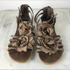 """[Report] Taupe Flower Gladiator Sandals 8 Gorgeous sandal with flowers covering the foot area. These get so many compliments!  Color: Taupe Material: Fabric & Faux Leather Size: 8 Heel Height: .25"""" Condition: Good. Some wear on footbed. Soles have scuffing and some scuffs on inner toe and heel. Shown in last picture. Report Shoes Sandals"""